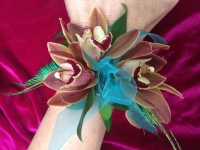 Cymbidium Orchid and Peacock Feather Wrist Corsage